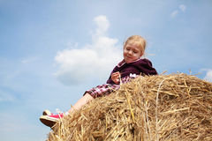 Young girl thinks in the hay Stock Images