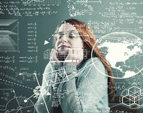 The young girl. Thoughful young girl search a solution to solve math problems Royalty Free Stock Images