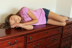 Napping on Furniture, Silly Tween royalty free stock images