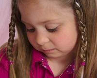 Young girl thoughtfully looking at something Royalty Free Stock Images
