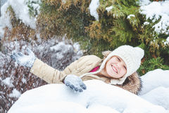 Young girl threw snow Stock Photography