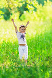 Young girl throwing her arms up Royalty Free Stock Photos