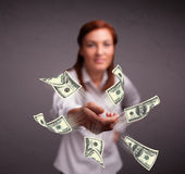 Young girl throwing money Royalty Free Stock Photo