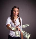 Young girl throwing money Royalty Free Stock Photography