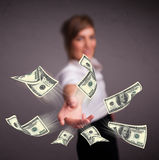 Young girl throwing money Royalty Free Stock Photos