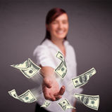 Young girl throwing money Royalty Free Stock Image