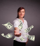 Young girl throwing money Stock Images