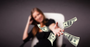 Young girl throwing money Royalty Free Stock Images