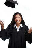 Young girl throwing student hat Stock Photos