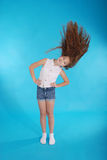 Young girl throws up her hair stock photo