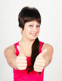 Young girl with thumb up Stock Photos