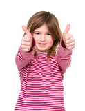 Young girl with thumbs up approval. Close up portrait of a smiling young girl with thumbs up approval, isolated on white royalty free stock photo