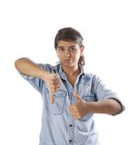 Young Girl Thumbs up and down Royalty Free Stock Photography