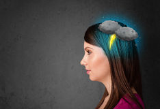 Young girl with thunderstorm lightning headache Stock Image