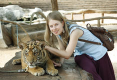 Young girl with a tiger Royalty Free Stock Image