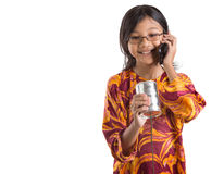 Young Girl With Tin Can Phone and Smartphone II Royalty Free Stock Image