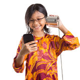 Young Girl With Tin Can Phone and Smartphone III Royalty Free Stock Photography