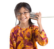 Young Girl With Tin Can Telephone V. An Asian young girl with tin can telephone over white background Stock Photos