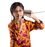 Young Girl With Tin Can Telephone VII. An Asian young girl with tin can telephone over white background Stock Image