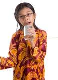 Young Girl With Tin Can Telephone VIII. An Asian young girl with tin can telephone over white background Stock Photos