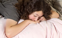 Young Girl Too Tired to Wakeup in Morning Royalty Free Stock Image