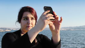 Young Girl Took Selfie near the Seaside stock video