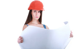 Young Girl with tools for building and a empty poster. Portrait of young female builder in helmet painting on white Royalty Free Stock Photography