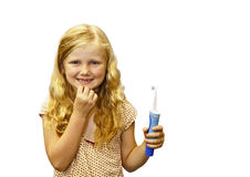 Young girl with toothbrush. Young girl, isolated,  holding her toothbrush Stock Photography