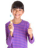 Young Girl With Toothbrush IV Royalty Free Stock Photos