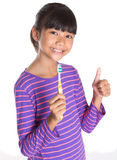 Young Girl With Toothbrush VI Royalty Free Stock Photography