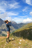 Young girl on top of Ferret Valley with binocular Stock Photo