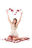 Young girl tossing rose petal Royalty Free Stock Image