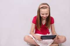 Young girl with touch tablet Stock Photo