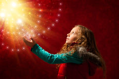 Young girl touching stars. Royalty Free Stock Photography