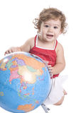 Young girl touching a world globe map Royalty Free Stock Photos