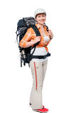 Young girl tourist with a big backpack in full length on white. Background stock image