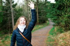 Young girl tourist in black jacket on walking trail in th forres stock images