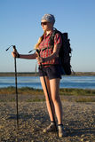 Young girl tourist with nordic walking Stock Image