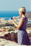 Young girl tourist uses a tablet Stock Photo