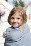 Young girl with a towel Stock Images