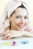 Young girl with towel Stock Images