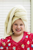 Young girl with towel around head. After shower at home Stock Photo