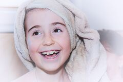 Young girl with towel on head Stock Photography
