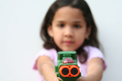 Young Girl With Toy Gun. Young girl on white background with a toy gun Royalty Free Stock Images