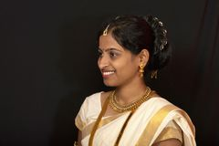 Young girl in traditional Kerala saree and jewelry stock photo