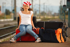 Young girl in train station Stock Photography