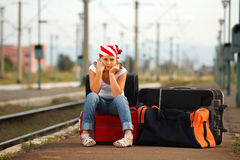 Young girl in train station Royalty Free Stock Images