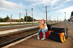Young girl in train station Royalty Free Stock Photography