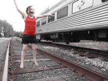 Young Girl On Train Tracks. Young barefoot girl on train tracks stock photography