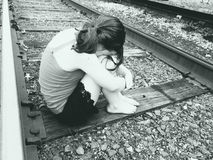 Young Girl On Train Tracks. Young barefoot girl on train tracks Stock Image